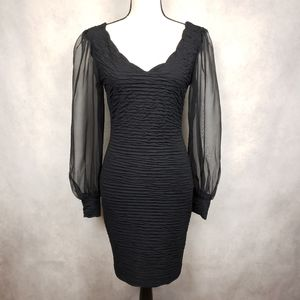 Vintage black bodycon dress with sheer sleeves